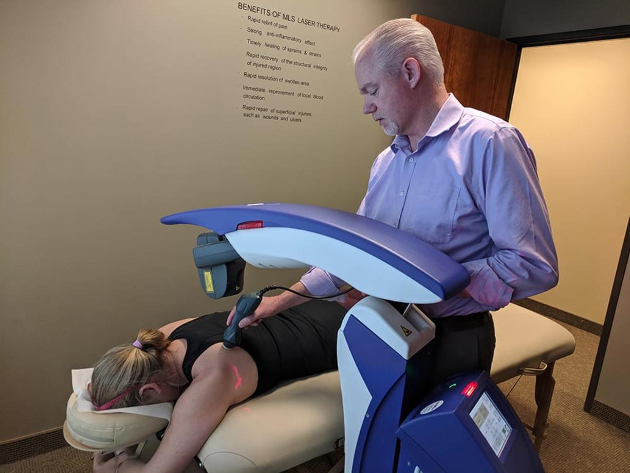 Dr. Peter Phillips administers laser treatment. The MLS Therapy Laser is the most advanced model on the market.