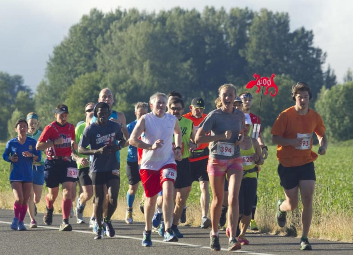 Runners take part in the Vancouver USA Marathon near Vancouver Lake on June 19, 2016. The 2017 Vancouver USA Marathon was canceled about a month before the race, prompting a proposed class-action lawsuit in federal court over registration fees.