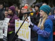 Matthea Freitag, 12, of Vancouver joins fellow students as she speaks about gun control to the crowd at Esther Short Park during the Vancouver March For Our Lives event.