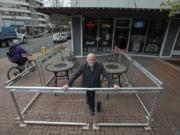 Daren Morgan, owner of Top Shelf Martinis on Main, pauses for a portrait in his outdoor patio space in downtown Vancouver. The city of Vancouver has told Morgan it won't renew permits for the patio unless it is reconfigured.