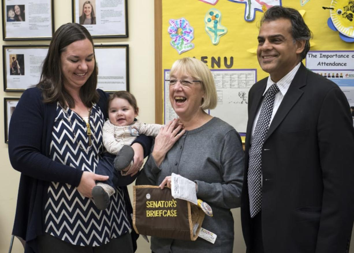 """Kimberly Pincheira, left, holds her son Alexander, 6 months, left, as they pose for a photo with Sen. Patty Murray and author Ajay Chaudry at the Hough Early Learning Center in Vancouver on Wednesday morning. Chaudry wrote, """"Cradle to Kindergarten: A New Plan to Combat Inequality,"""" and is joining Murray's efforts to fight for affordable child care."""