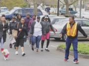 Gerald Dory, right, leads a neighborhood walk during a Let's Get Moving meeting. The program is a culture-specific program that takes aim at health disparities among black people.