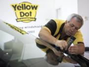 Steve Harmon, owner of Yellow Dot Windshield Repair, prepares a chip for repair at his shop in Vancouver on Wednesday afternoon. Harmon started his business in 2003 and spent many years at Vancouver Mall. He recently relocated to his own shop on East 18th Street.