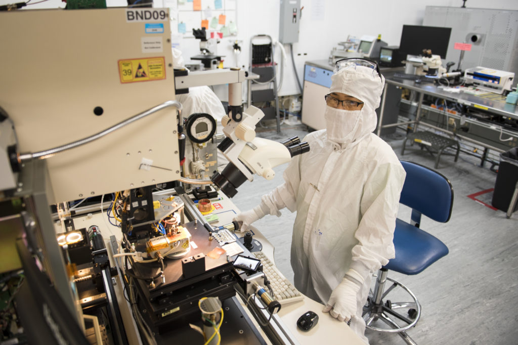 nLight production operator Wilma Marron, of Vancouver, works in the company's laser manufacturing process. The company began its first day of public trading on April 25 and closed strong.
