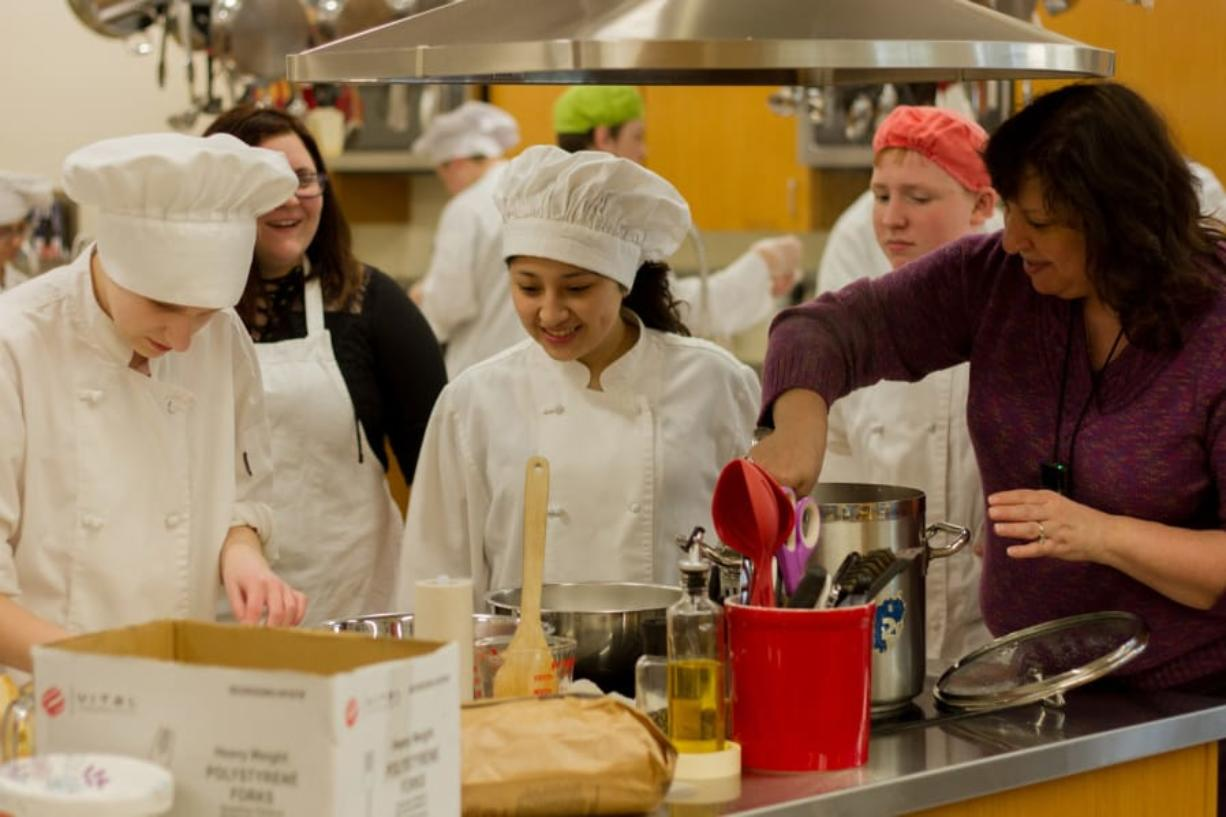 Woodland: Kimberly Miller, right, teaches culinary arts and other career and technical education classes at Woodland High School while also coaching the school's SkillsUSA Team, which was recently recognized as a National Model of Excellence.