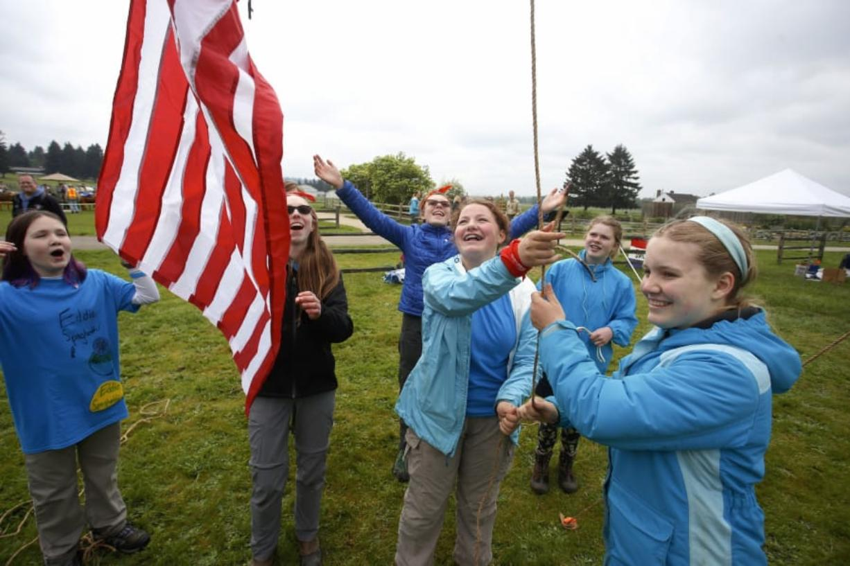 From left, Allison Mckellar, 11, Ellie Stewart, 14, Helen Dreasher, 12, Viridian Klei, 13, Freya Rozell, 13 and Anneke Talke, 13, raise a flag at the Boy Scouts' 2018 Camporee on Saturday. Their unit, called Eddie Spaghetti Patrol, was one of two all-girls units at the weekend event.