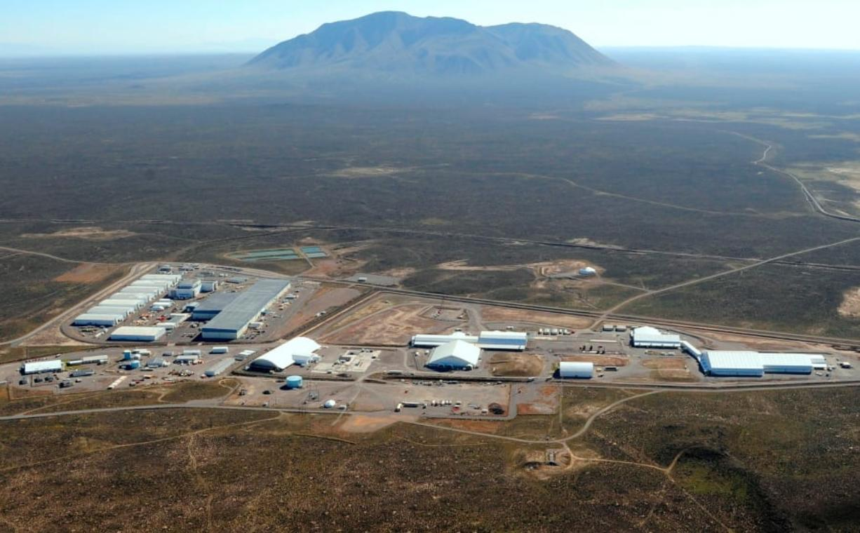 The Radioactive Waste Management Complex, as seen from above in 2016, at the federal nuclear site in eastern Idaho. Officials at the eastern Idaho nuclear site where a radioactive sludge barrel ruptured inside a contained building say three more barrels have ruptured and a closed-circuit video monitor has been set up. U.S. Department of Energy contractor Fluor Idaho said a crew wearing protective gear entered the building Wednesday to put in the monitoring system where the four 55-gallon barrels ruptured. U.S.
