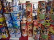 People browse the aisles at a fireworks stand benefiting the Brush Prairie Baptist Church Revolution Student Center at NE 63rd Street and NE Andresen Road on Sunday July 1, 2012.