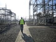 Bonneville Power Administration Principal Structural Engineer Leon Kempner walks through Ross Complex in Vancouver, one of many assets that could have been sold had the Trump administration moved forward with its proposal to privatize the BPA.