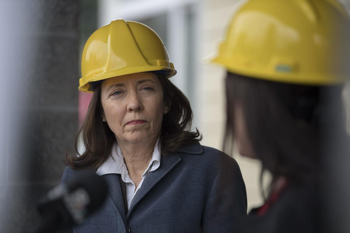U.S. Sen. Maria Cantwell, D.-Wash., left, listens as Alishia Topper of the Vancouver City Council speaks on the topic of affordable housing at Meriwether Place at the end of March 30.