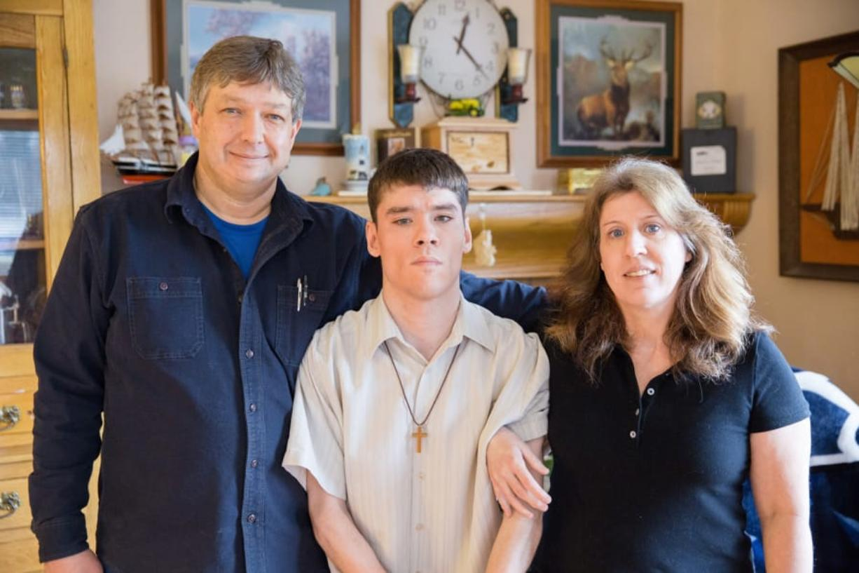 Ben Olson of Camas, left, poses for a family photo. A state-paid caregiver for his medically fragile son, he became disillusioned with the Service Employees International Union.