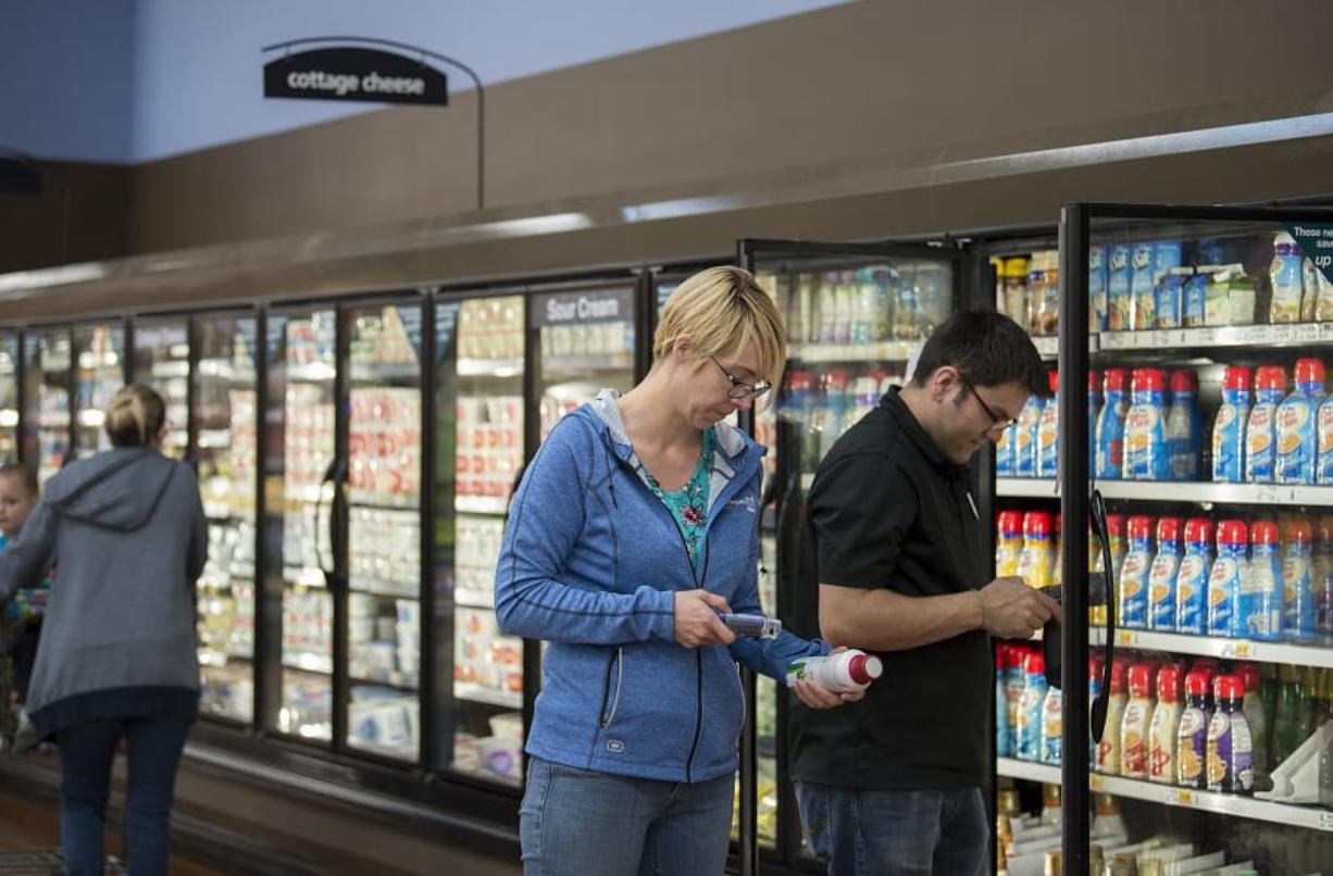 Camas resident Melissa Hansen uses a hand-held scanner to keep track of her grocery purchases at Fisher's Landing Fred Meyer in east Vancouver. The use of the scanners is one of a few new initiatives the grocery chain is introducing to keep pace with an evolving industry.