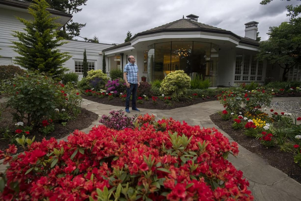 Jim Mains of the Ed and Dollie Lynch estate pauses for a photo outside the late philanthropists' former home. At 4712 N.W. Franklin St., Vancouver, the 12,000-square-foot home is one of 20 high-end homes open to the public on Sunday.