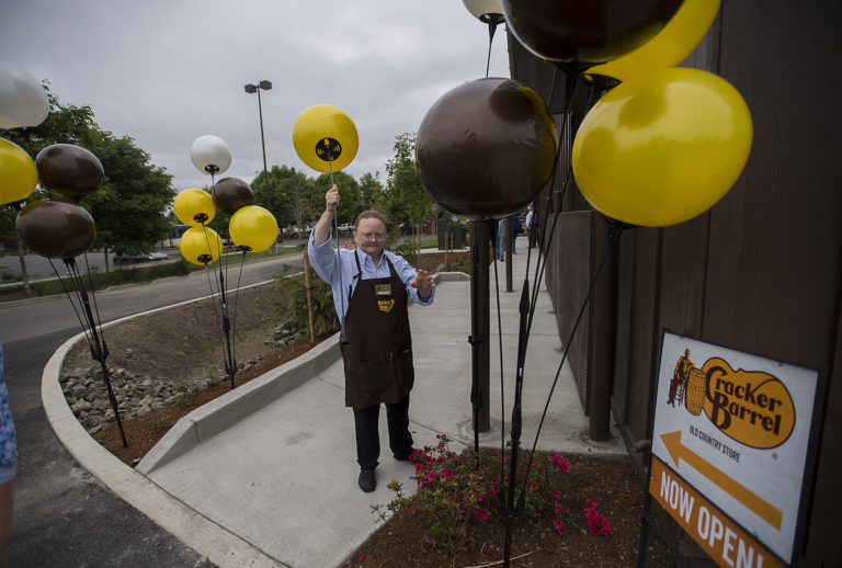 Guest services representative Serena Branner helps decorate the exterior of the new Cracker Barrel in Jantzen Beach for customers Monday morning, May 21, 2018.
