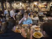 Jerry Roulette of Vancouver, center in blue, eats breakfast with his family at the new Cracker Barrel Old Country Store in Jantzen Beach on Monday morning. Cracker Barrel has more than 650 locations nationwide.