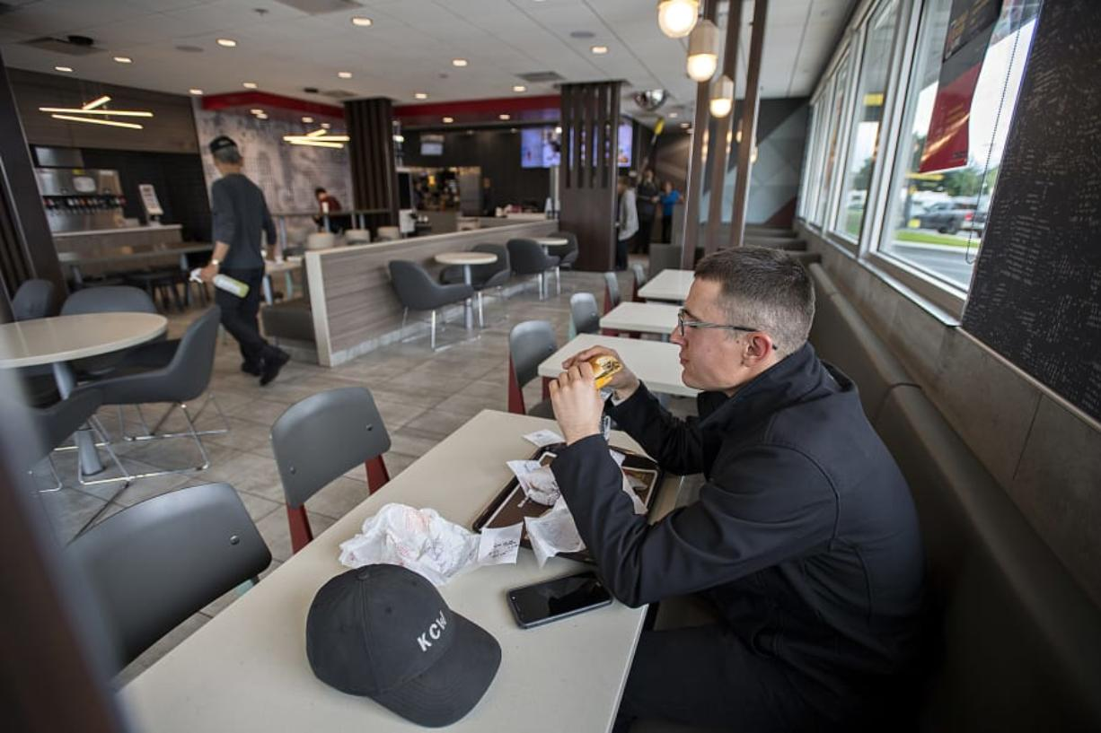 Vancouver resident Daniel O'Connell relaxes in a booth on his lunch break at the McDonald's at 2814 N.E. Andresen Road in Vancouver, which is one of several local restaurants that has been upgraded to provide casual relaxation for diners.