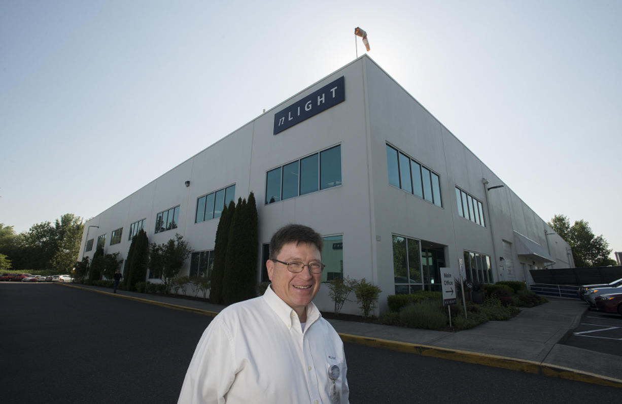 Mark DeVito, vice president of device engineering at nLIGHT, pauses for a photo outside the firm's Vancouver office. DeVito helps steer the technology that has helped make nLIGHT a valuable, publicly traded company.