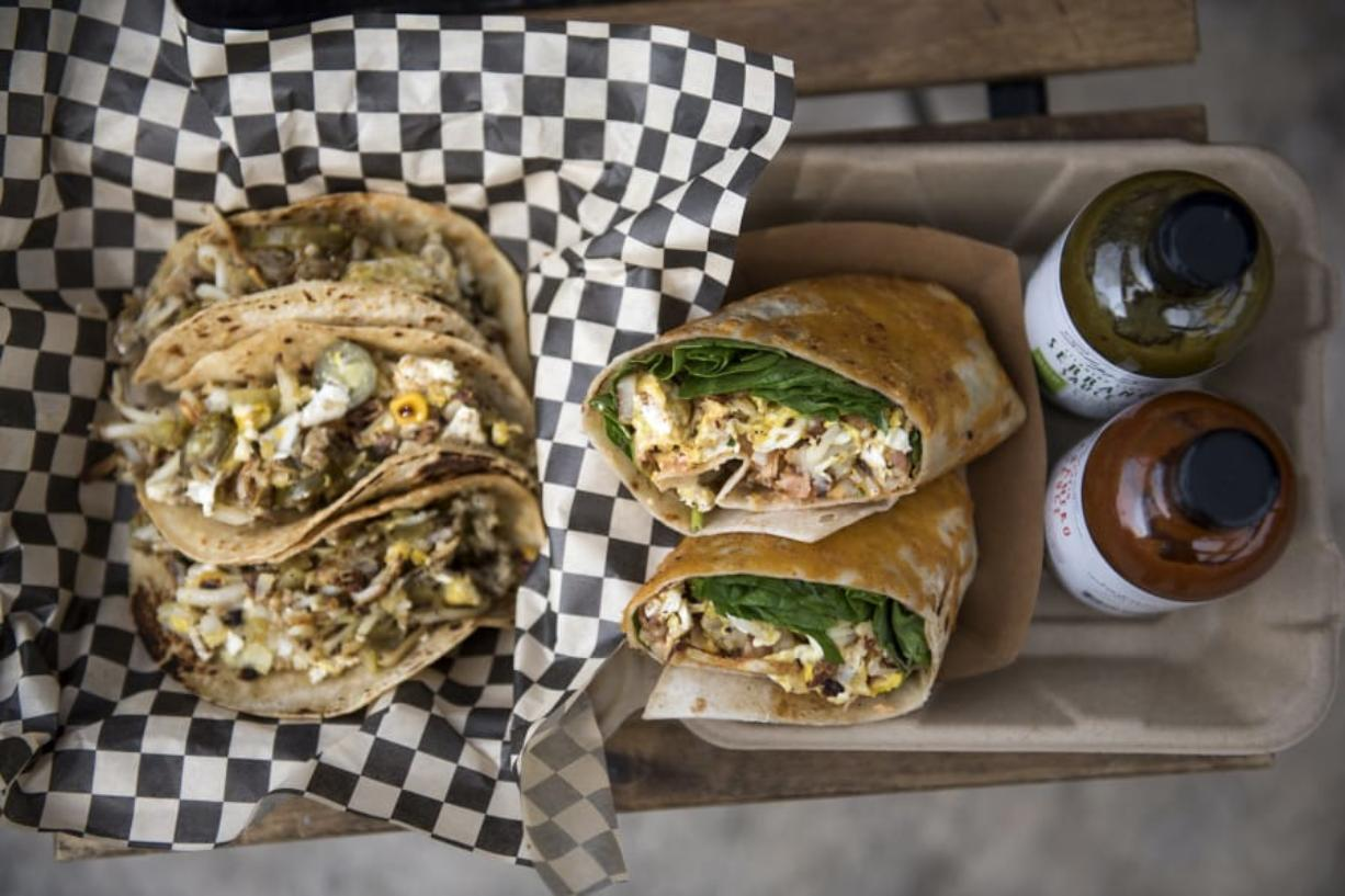 The taco-style ABQ, left, and the burrito-style Couve-Delish, at Mack Shack in downtown Vancouver.