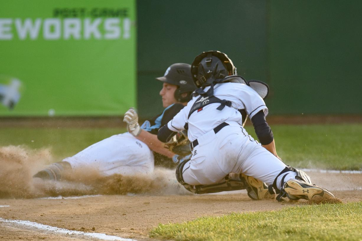 Freeman's Desmond Parisotto slides in safely ahead of the tag by King's Way Christian catcher Hunter Aarhus during the Class 1A state championship game Saturday in Yakima.