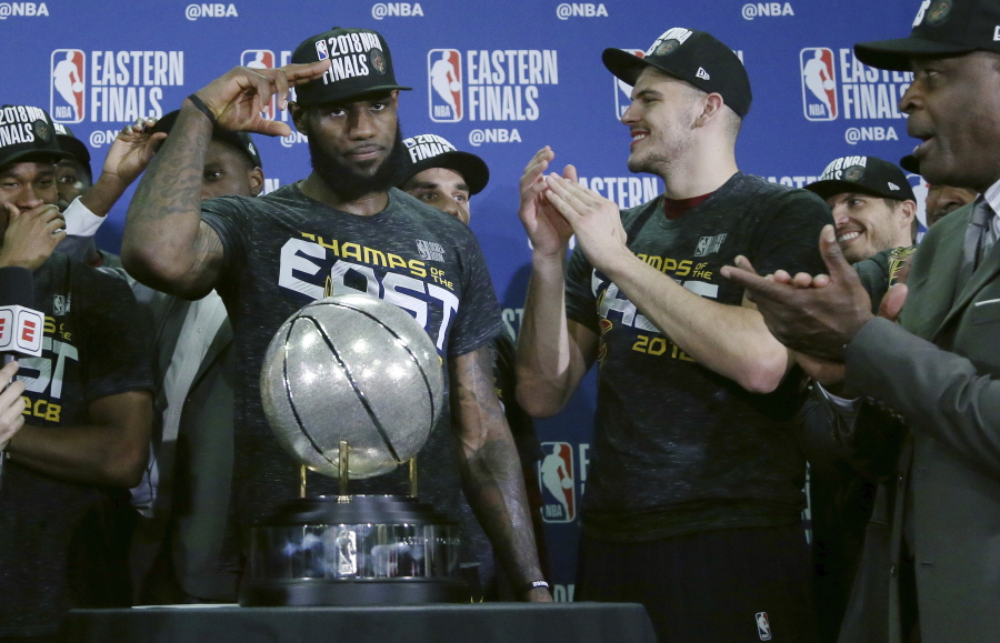 12808453642 Cleveland Cavaliers forward LeBron James salutes after his team was  presented the trophy for beating
