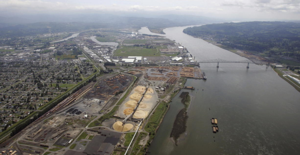 Timber processing facilities line the banks of the Columbia River in Longview near the Lewis and Clark Bridge on May 12, 2005. Six Western states and several national industry groups have lined up against Washington state in a legal battle over its decision to reject permits for a massive proposed coal-export terminal on the Columbia River.