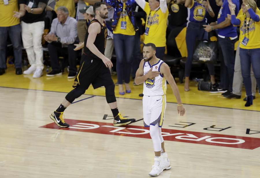 12c1f54b647 Golden State Warriors guard Stephen Curry (30) celebrates in front of  Cleveland Cavaliers forward