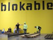 Workers assemble components at Blokable's production facilities during a recent visit from Gov. Jay Inslee. The Seattle company makes its modular housing units — called bloks — in Vancouver.