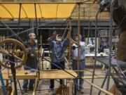 National Park Service volunteers work on a full-scale replica of the Curtiss Pusher that flew from Portland to Pearson Field in 1912. It will go on display Saturday at Pearson Air Museum.