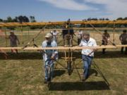 The team of volunteers who built the full-size 1912 replica biplane and Fort Vancouver staff move the plane Tuesday to Pearson Air Museum at Fort Vancouver National Historic Site.