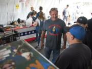 Mean Gene Fireworks owner Gene Marlow talks with customers at one of his fireworks stands on opening day.