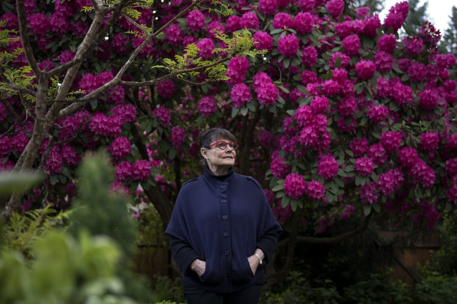 Vanessa Gardner Nagel Stands In Front Of A Large Rhododendron At Her Home Vancouver