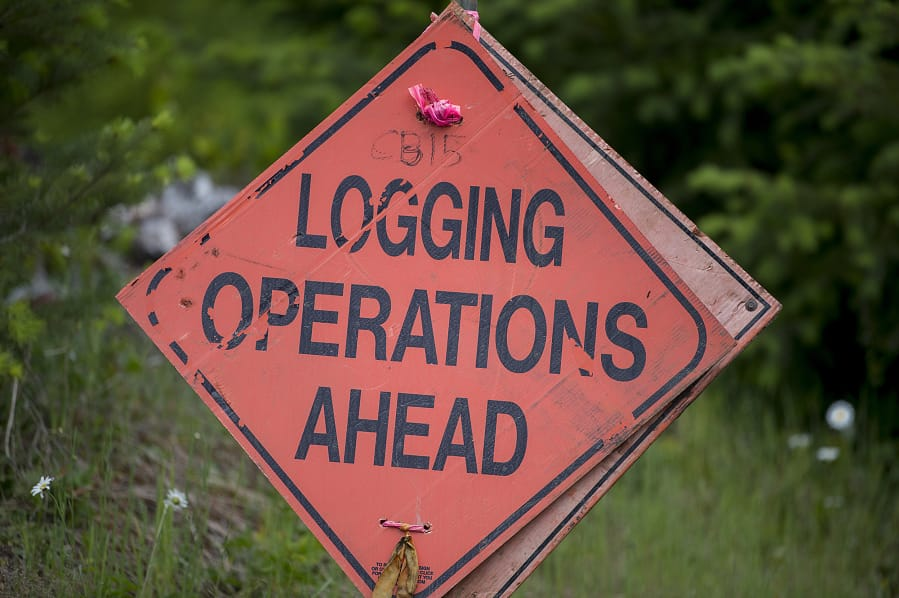A sign posted in a stretch of Columbia Land Trust timberland near Swift Reservior alerts visitors that logging operations are underway. The organization plans to use forestry over the next 80 years to give the area the characteristics of an old-growth forest.