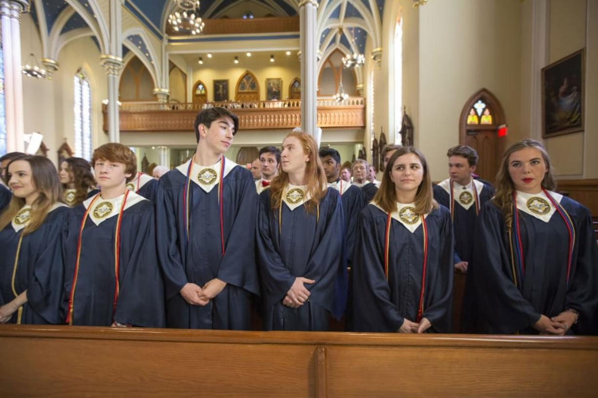 Seton Catholic College Preparatory High School's graduating seniors stand in a pew Friday during their baccalaureate ceremony at Proto-Cathedral of St. James the Greater in Vancouver.