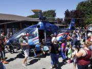 People crowd around the Lifeflight helicopter at the Clark County Fire District 6 open house.