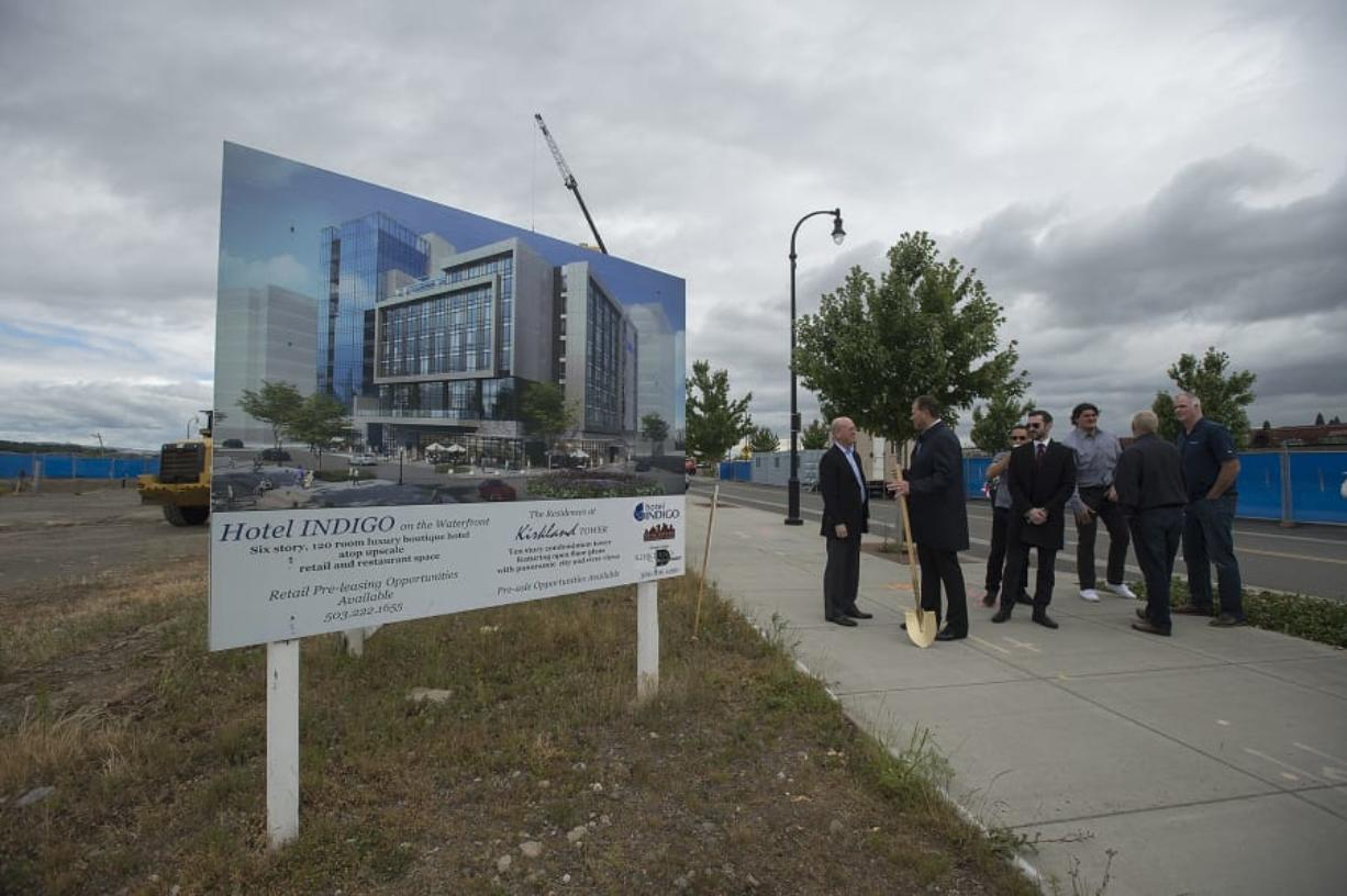Dean Kirkland, second from left, chats with colleagues and supporters after the groundbreaking of Hotel Indigo and Kirkland Tower. The two buildings will be the sixth and seventh buildings at The Waterfront Vancouver.