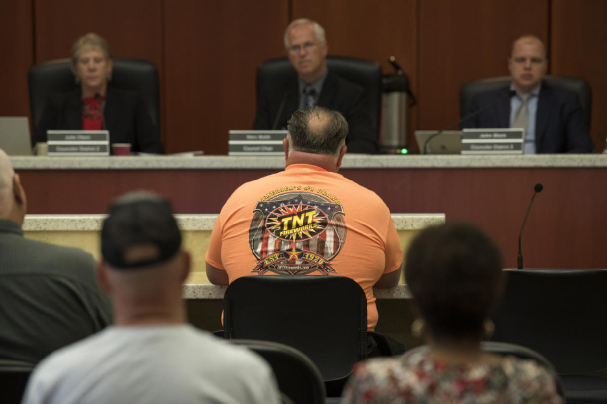 Beau Leach, operator of TNT Fireworks Warehouse, addresses the council in support of preserving the current state standard on fireworks during the Clark County Council meeting Tuesday. Leach called the eventual vote, which only allows people to shoot fireworks on July 4, a fair compromise.