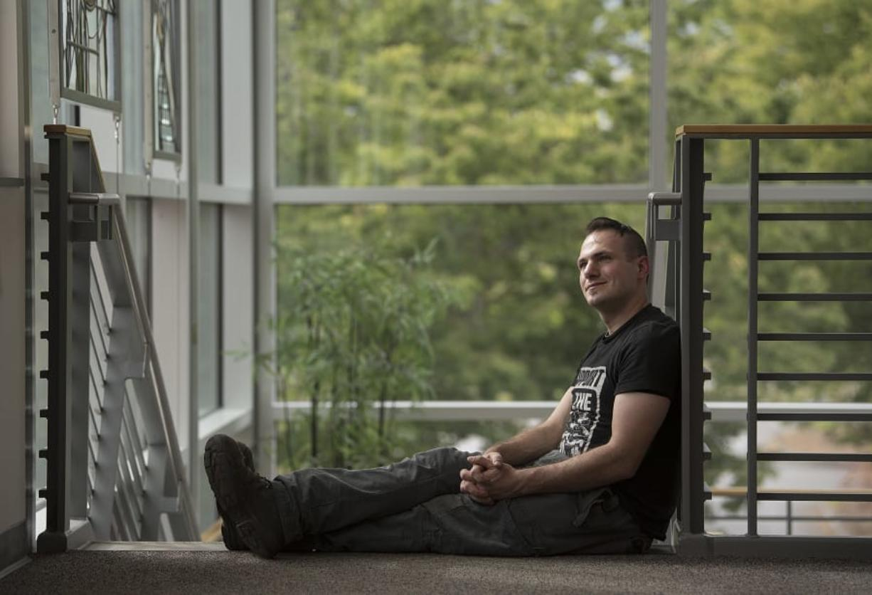 Clark College graduate Jonathan Dutson, on campus Thursday afternoon, is one of 700 students expected to graduate this week. Dutson overcame abuse as a child to earn his degree in machining technology. (Amanda Cowan/The Columbian)
