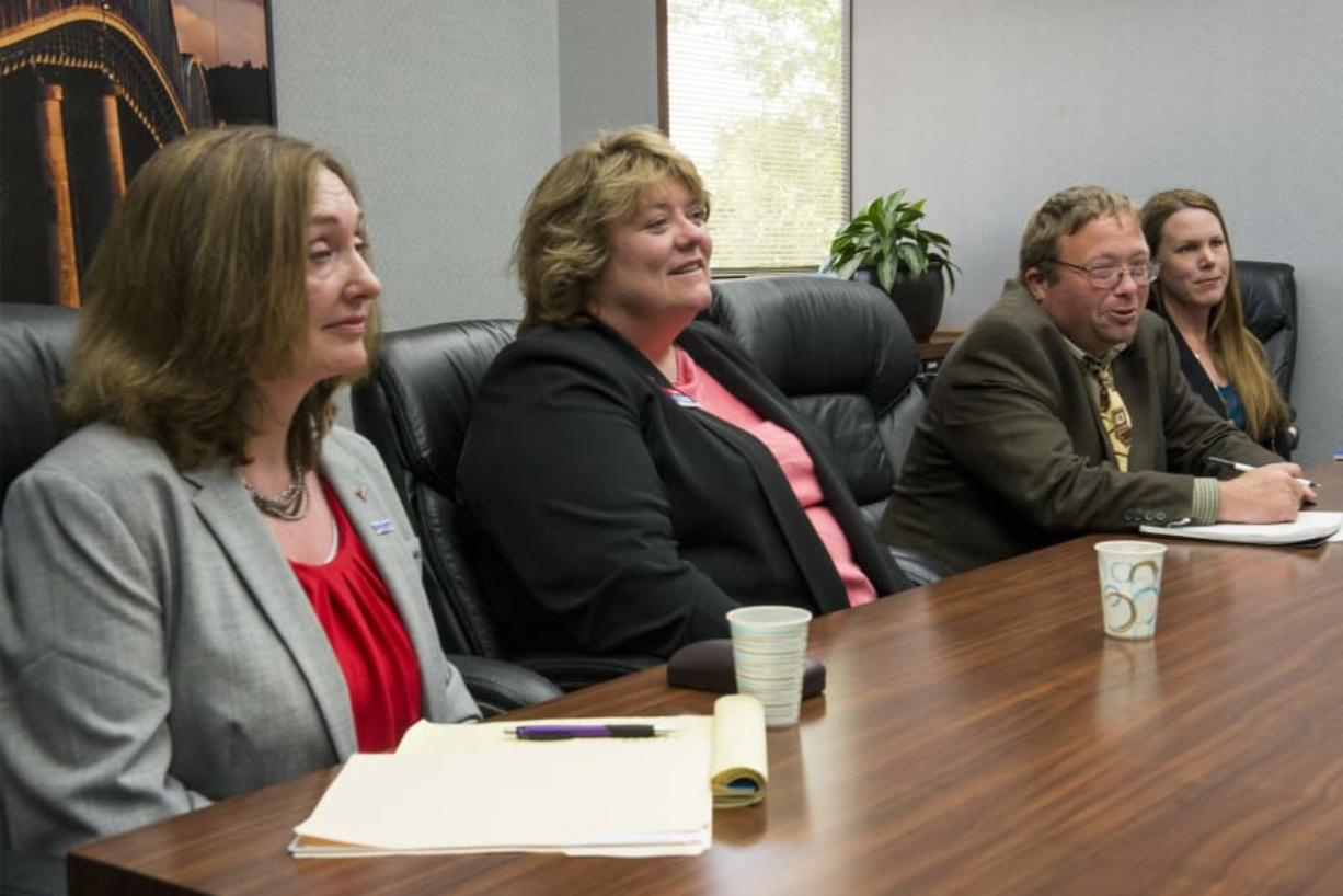 Vancouver City Councilor Laurie Lebowsky, from left, candidate Mary Elkin, candidate Adam Shetler and candidate Sarah Fox speak with The Columbian's Editorial Board.