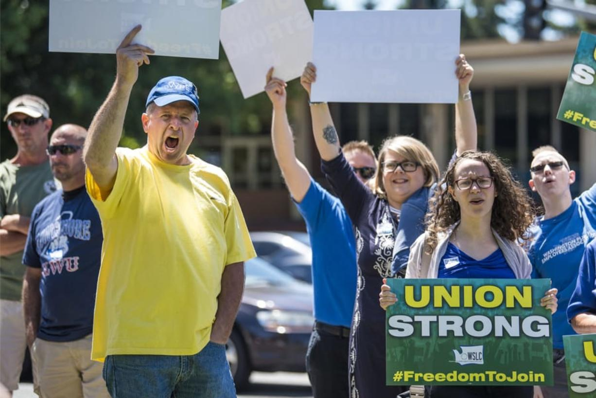 Union members and supporters rally against the U.S. Supreme Court's decision in Janus v. AFSCME at the corner of Fort Vancouver Way and East Mill Plain Boulevard on Wednesday afternoon.