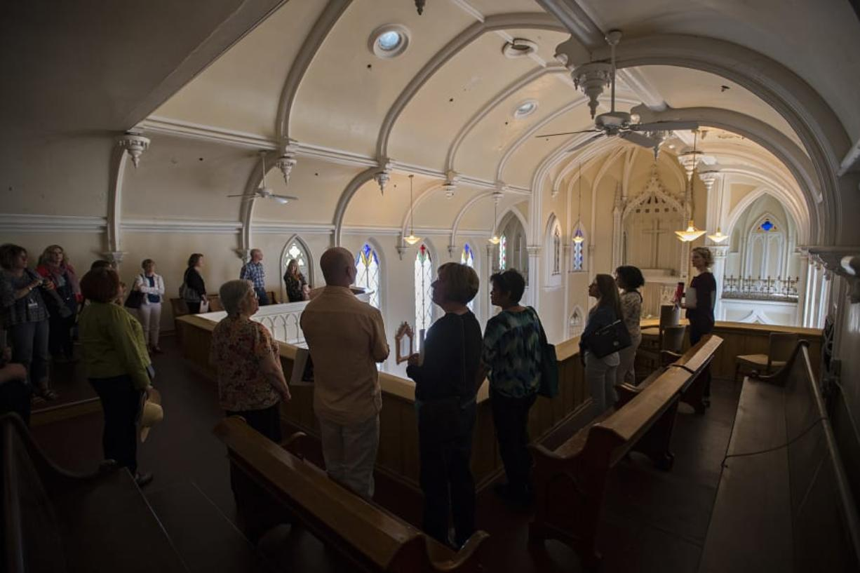 Employees from Providence Health & Services pause to take in the view from the chapel balcony at Providence Academy during a Wednesday tour of the historic building in Vancouver.