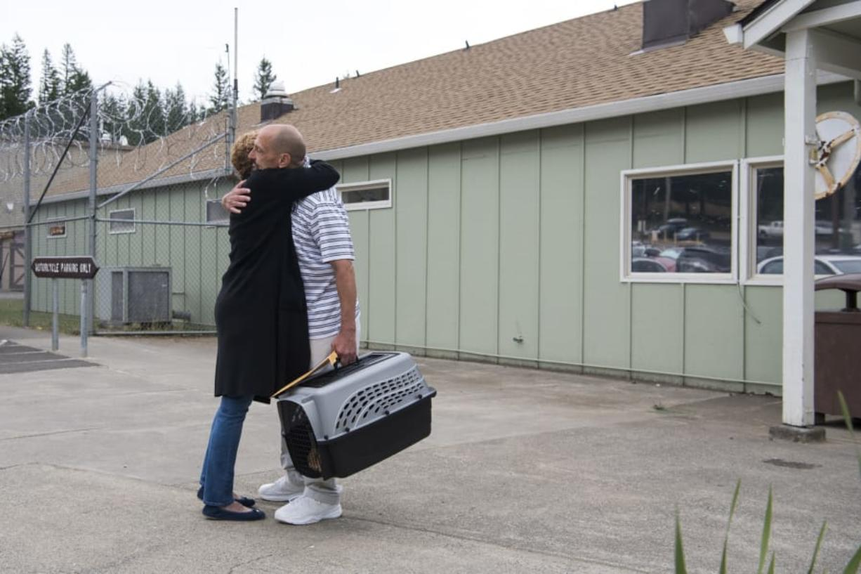 Craig Bigler embraces his mother, Lezlie Deuchrass, after being released from Larch Corrections Center near Yacolt on Thursday morning. Bigler participated in the Larch Pet Training Camp for cats for 18 months during his time at the corrections center.