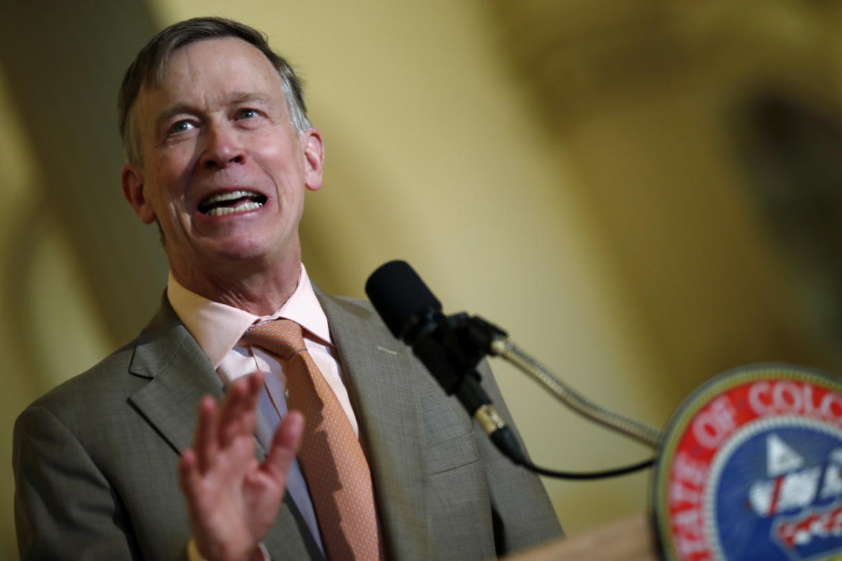 In this May 30,2018 file photo Colorado Gov. John Hickenlooper speaks at the state Capitol. On Tuesday, June 19, 2018, Hickenlooper ordered state regulators to adopt California's vehicle pollution rules, joining other states in resisting the Trump administration's plans to ease up on emissions standards. Hickenlooper, a Democrat, told regulators to try to have the new vehicle standards in place by the end of the year.