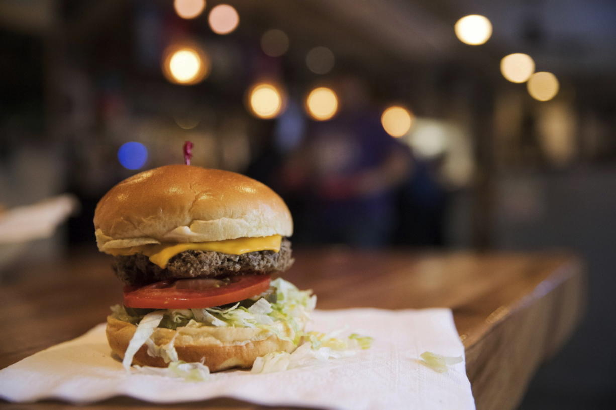 """The Impossible Burger at Stella's, in Bellevue, Neb., is a burger is made from plant protein. What gets to be considered """"meat"""" is a particularly touchy subject as startups push to alter American eating habits with substitutes they say are just like the real thing. Impossible Burger's plant-based patty """"bleeds"""" like beef."""