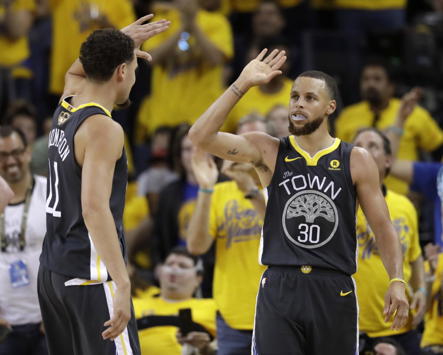 a80893f017b9 Golden State Warriors guard Stephen Curry (30) celebrates with guard Klay  Thompson (11