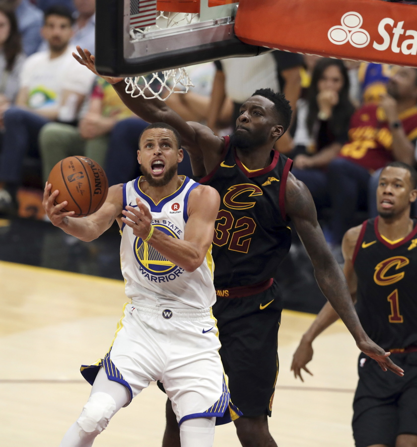 cb269b3aa1a4 Golden State Warriors  Stephen Curry shoots in front of Cleveland  Cavaliers  Jeff ...