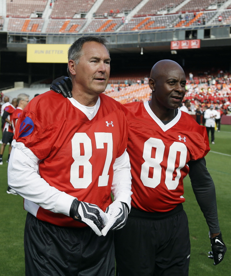 c06e4707e Former San Francisco 49ers wide receivers Dwight Clark, left, and Jerry  Rice, right