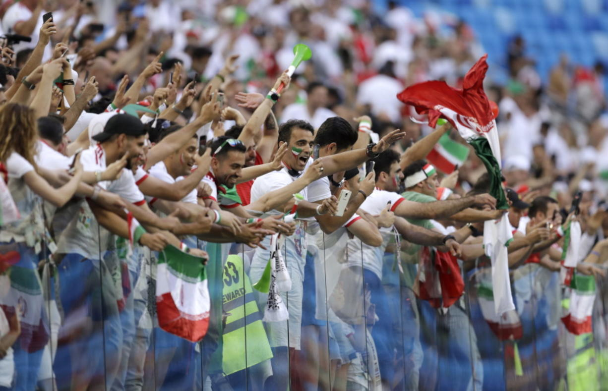 Fans for Iran celebrate the team's victory after the group B match between Morocco and Iran at the 2018 soccer World Cup in the St. Petersburg Stadium in St. Petersburg, Russia, Friday, June 15, 2018.