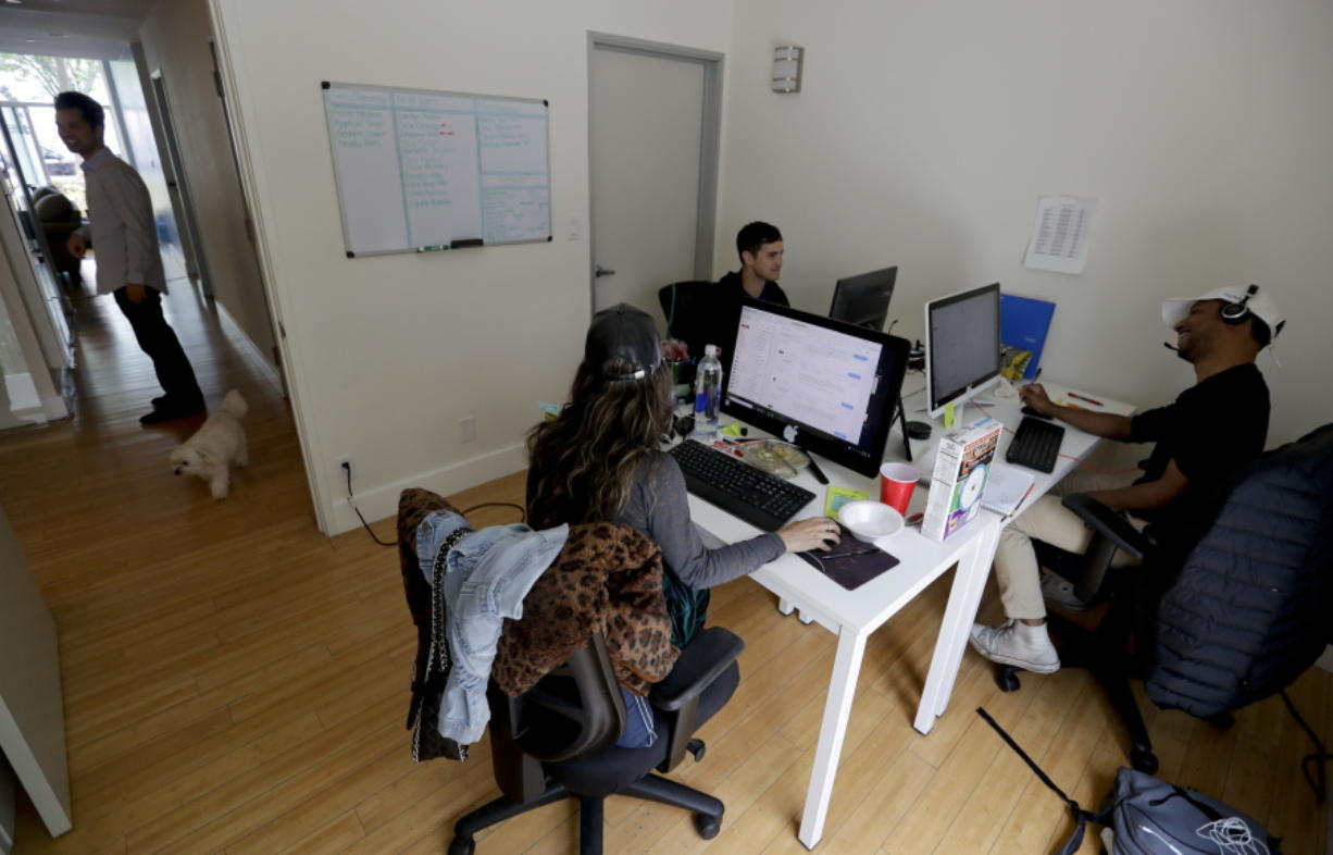 People work in the offices of HeyTutor, an online company that matches tutors with students in Los Angeles.