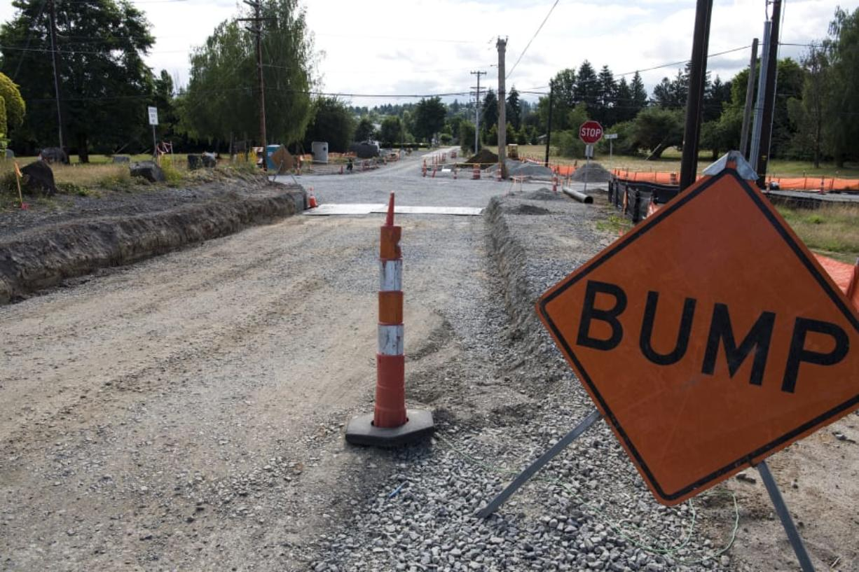 Construction has been steady at the intersection of 154th Street and 10th Avenue. But because of state law, the county is having trouble funding a related project.