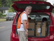 Daniel Jensen, an Amazon Flex independent contractor, delivers packages in Vancouver on Thursday morning.